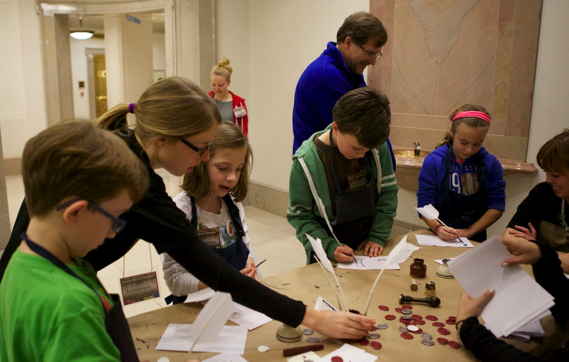 Here some of our sleepover attendees experiment writing with quill pens, just like our earliest presidents!