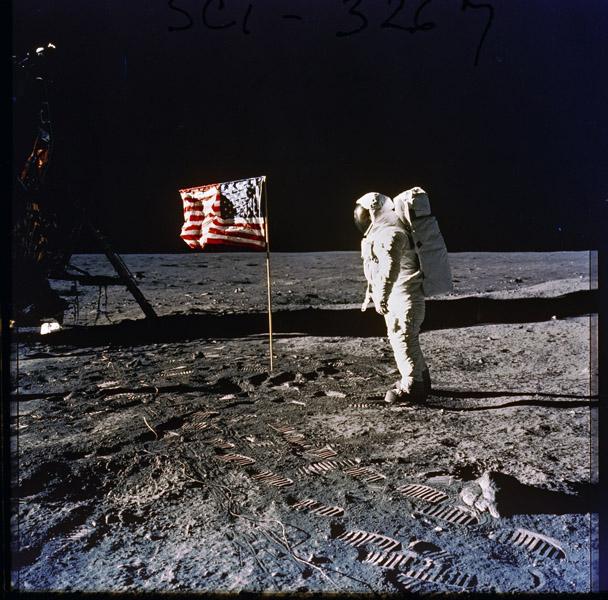 Astronaut Edwin E. (Buzz) Aldrin, Jr. Posing on the Moon Next to the U.S. Flag