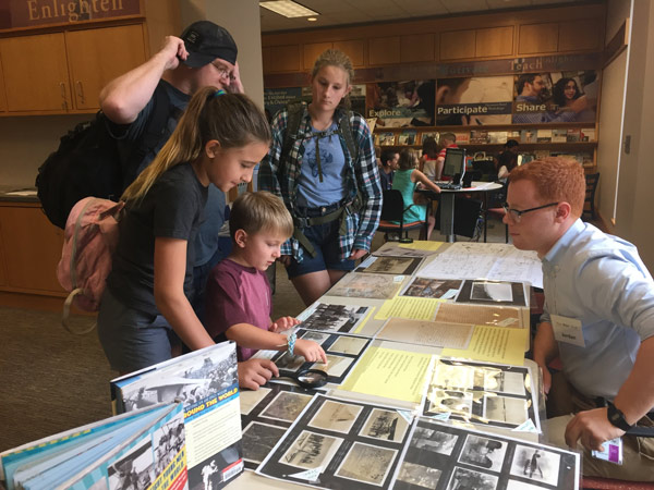 Visitors looking at books and photographs