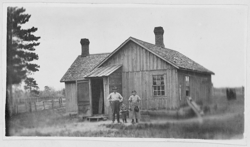 People standing in front of a house
