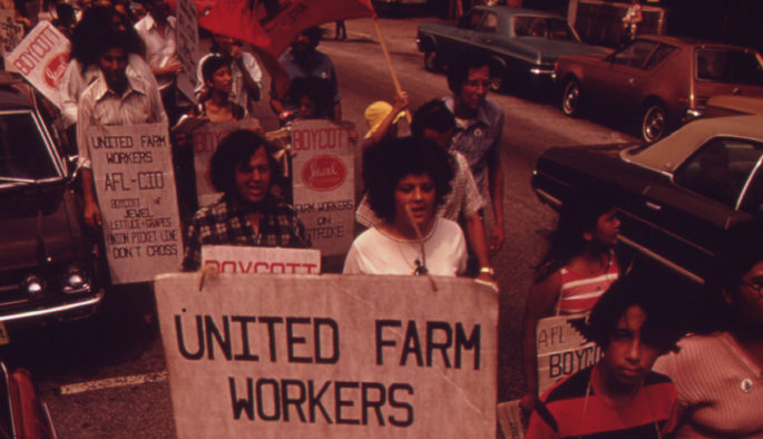 Union workers holding picket signs